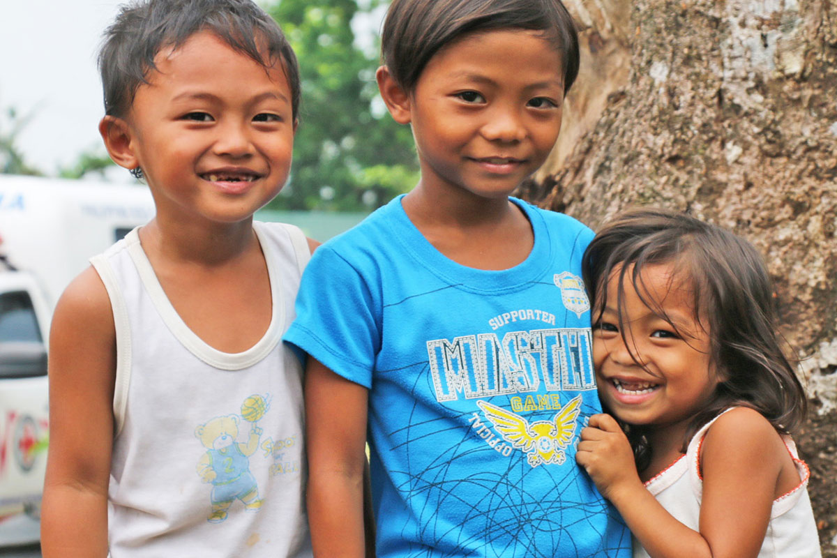 These three kids have big smiles – and so should you: We have exciting news about our agencies in the Philippines!