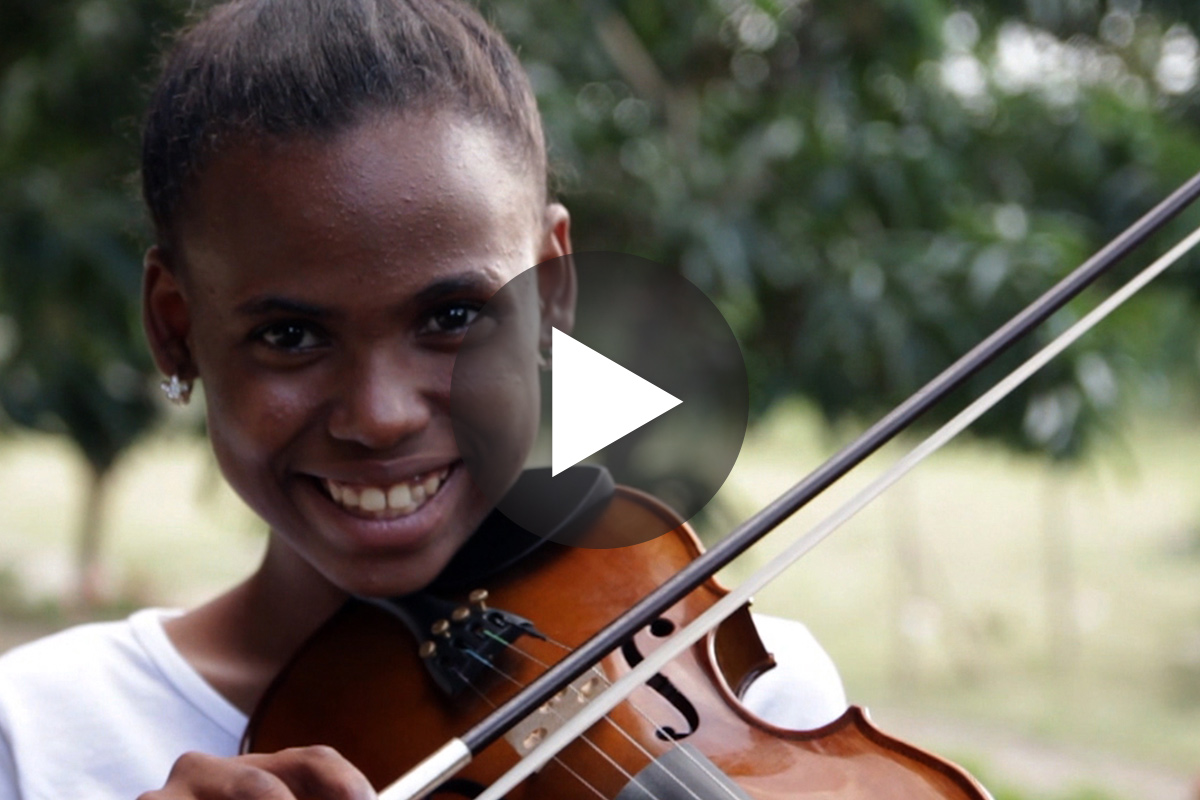 Student musician plays violin