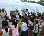Sponsored youth volunteer in a child-friendly space during the Mount Mayon evacuation in Legazpi, Philippines.